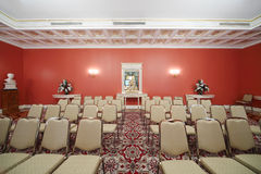 Rows of chairs in Red Hall in Guest extension Royalty Free Stock Image