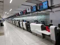 Rows of check in counters at the airport Stock Photo