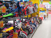 Rows of childrens bikes in a toy store. Royalty Free Stock Images