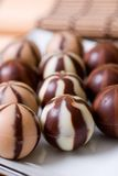 Rows of chocolate candies. Rows of chocolate striped candies royalty free stock photography