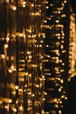 Rows of Christmas lights at night, selective focus. Rows of Christmas lights outside at night, bokeh, selective focus stock images