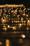 Rows of Christmas lights at night, selective focus. Rows of Christmas lights outside at night, bokeh, selective focus stock photos