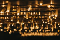 Rows of Christmas lights at night, selective focus. Rows of Christmas lights outside at night, bokeh, selective focus royalty free stock photography