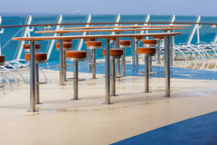 Chrome and Wood Stools on Cruise Ship Stock Photography