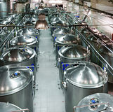 Rows of cisterns from food stainless steel. Modern brewing production stock photos