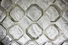 Rows of clear glass drinking glasses Royalty Free Stock Images