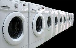 Rows of clothes washers. Rows of modern clothes washers isolated at the black background Stock Images