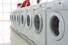 Rows of clothes washers in a store 2. Rows of modern clothes washers in a store Stock Image