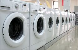 Rows of clothes washers in a store. Rows of modern clothes washers in a store Royalty Free Stock Photo