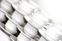 Rows of coffee cups with saucers Royalty Free Stock Photos