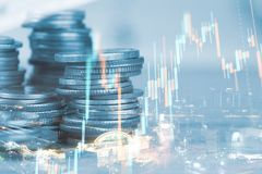 Rows of coin and graph of stock market trade. Indicator financial for investment strategy stock images