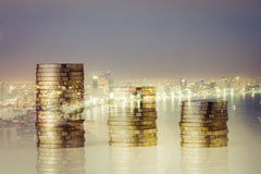 Rows of coins with  city night background Royalty Free Stock Images