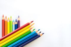 Rows of Color pencils on white paper background, copy space. Office supplies, back to school stock image