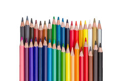 Rows of colored pencils isolated on white Royalty Free Stock Photos