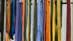 Rows of colorful belts in the shop for men and women. stock photo