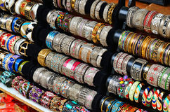 Rows of colorful bracelets on jewelry market Stock Photos