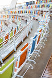 Rows of Colorful Canvas Chairs Curving Around an Arena Stock Photography