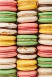 Rows of colorful french macarons. Creative background royalty free stock photos