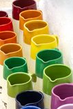 Rows with colorful glazed ceramic jars, flower pots, vases for s. Ale royalty free stock images