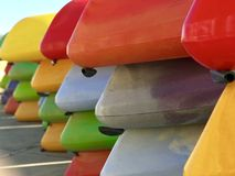 Rows of colorful kayaks stock images