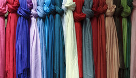 Rows of Colorful Knotted Scarves. Rows of colorful fabric knotted women's scarves Royalty Free Stock Image