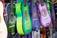 Colorful guitars for kids on the display royalty free stock photo