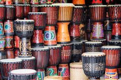 Rows of colorful wooden djembe drums at souvenir shop. Fenghuang, China - September 22, 2017: Rows of colorful wooden djembe drums at souvenir shop in Phoenix royalty free stock images