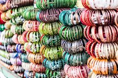 Rows of colorful wooden hand-painted bracelets Stock Photography