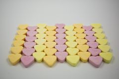 Rows of Colourful Candy Hearts royalty free stock photography