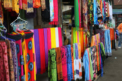 Rows of colourful silk scarfs hanging at a market stall in Indon Royalty Free Stock Image