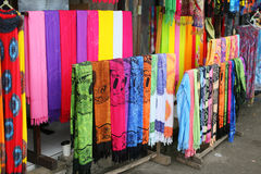 Rows of colourful silk scarfs hanging at a market stall in Indon Royalty Free Stock Photography