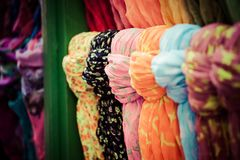Rows of colourful silk scarfs hanging at a market stall in Istanbul, Turkey Royalty Free Stock Images