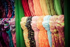 Rows of colourful silk scarfs hanging at a market stall in Istanbul, Turkey Stock Images