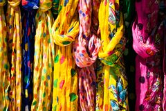 Rows of colourful silk scarfs hanging at a market stall in Istanbul, Turkey Royalty Free Stock Image