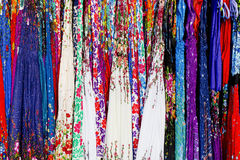 Rows of colourful silk scarfs hanging at a market stall in Thail Royalty Free Stock Photography