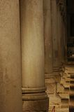Rows of columns in a roman basilica. Rows of 1600 year old columns in a roman basilica in Italy. these beautiful columns have been integrated into the building Royalty Free Stock Photos