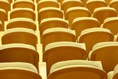 Rows of comfortable chairs with wooden back Stock Images