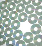 Rows of compact disks. An arrangement of compact disks in a repetitive pattern with one missing. Suitable for abstract background stock image