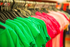 Rows of cotton T-shirts. In a large store Royalty Free Stock Images