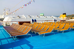 Rows of deck chairs on cruise ship Stock Photography