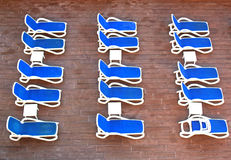 At the swimming pool. Row of deckchairs waiting for guests Stock Photo