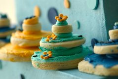 Rows of delicately decorated gourmet cookies Stock Photos