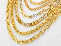 Rows of designed gold chains Stock Photography