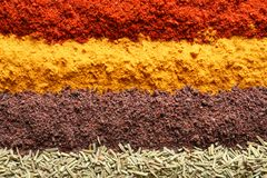 Rows of different aromatic spices as background royalty free stock photography