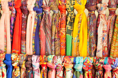 Rows of different brightly colored fabrics Stock Photo