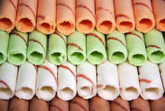 Rows of different color egg rolls Stock Images