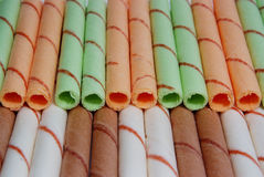 Rows of different color egg rolls Stock Photography