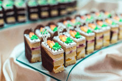 Rows of different dessert cakes on the candy bar Stock Photography