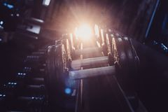 Rows of dumbbells in the gym with hign contrast. Stock Images