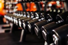Rows of dumbbells in the gym with hign contrast. In the gym royalty free stock images